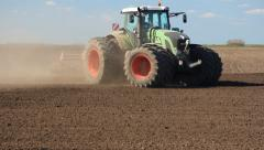 Big tractor preparing field for sowing - stock footage