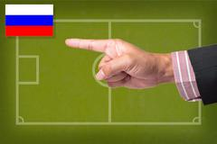 hand point a soccer game strategy on a blackboard - stock illustration