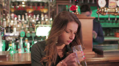 Pensive blonde drinking Stock Footage