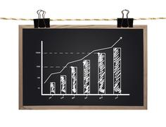 blackboard with chart - stock photo