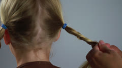 Cute Girl Scout Child Pigtail Blonde Hair gets Braid into Braid from Behind Stock Footage