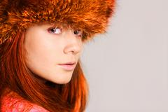 Stock Photo of young woman in a furry hat