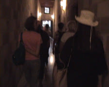 Tourists walking down a narrow passage in the Palace of the Grandmasters Stock Footage
