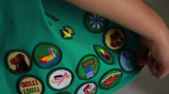 Girl Scout Uniform on Child that Shows Merit Badges and Awards from Childhood Stock Footage