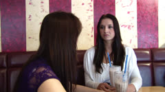 Stock Video Footage of HD1080i Two girls having Milkshake in Cafe