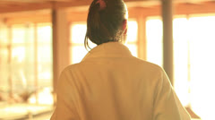 Girl takeing off bath robe Stock Footage