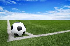 Soccer football field stadium grass line blue sky background Stock Photos