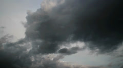 Threatening Grey Cloud Formation in Blue Sky - 25FPS PAL Stock Footage