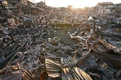after fire at slum in bangkok, thailand - stock photo