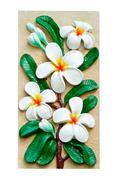 Stucco images of frangipani flowers. Stock Photos