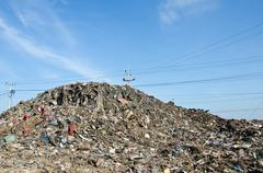 rubbish dump of landfill garbage - stock photo