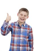 cute boy with thumb up - stock photo