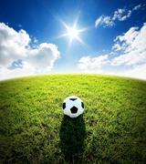 Football field soccer stadium on the green grass blue sky sport game backgrou Stock Photos