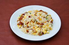 Fried rice with ham. - stock photo