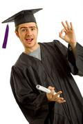 happy young man after his graduation, isolated on white - stock photo