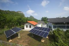 solar panel providing power to a rural area in thailand - stock photo