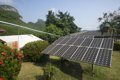 Solar panel providing power to a rural area in thailand Stock Photos