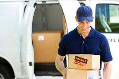 delivery: standing by van with boxes - stock photo