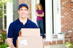 Delivery: dropping off packages Stock Photos