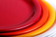 Colorful melamine/ceramic plates stacked - stock photo