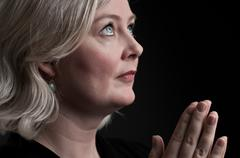 Caucasian Woman In Prayer Stock Photos