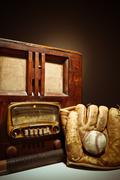 Antique radio with baseball mit and glove Stock Photos