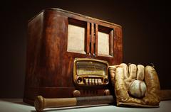 antique radio with baseball mit and glove - stock photo