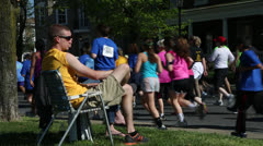 Spectators and 10K marathon runners  EDITORIAL USE ONLY Stock Footage