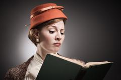 Retro styled woman reading a book Stock Photos