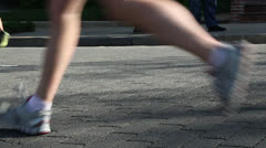 Marathon runners close up of legs and feet during race  EDITORIAL USE ONLY Stock Footage