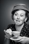 Retro woman drinking her tea Stock Photos