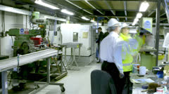 Time lapse of busy workers in the office section of a warehouse or factory Stock Footage