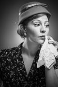 retro woman dabbing her mouth with handkerchief - stock photo