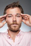 caucasian man with a wide headache - stock photo