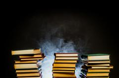 Smoldering Stacks Of Old Books Stock Photos