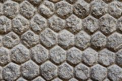 texture of a wall with stones and masonry shaped of hexagons - stock photo