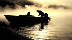 Fisherman get dawn from boat Stock Footage