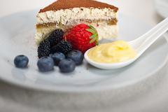 tiramisu dessert with berries and cream - stock photo