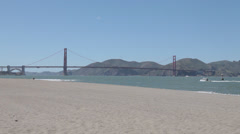 The Golden Gate Bridge from the beach at Crissy Field - stock footage