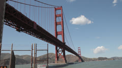 Looking up at the underside of Golden Gate Bride on a sunny windy day Stock Footage