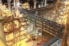 Lighting of petrochemical factory in night time Stock Photos