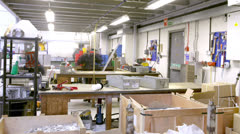 Time lapse clip of a busy team of manual workers in a factory or warehouse  - stock footage
