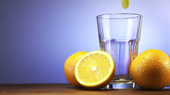 Orange juice pouring in glass Stock Footage