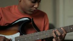 Teenager playing guitar Stock Footage
