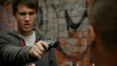 Teenager with gun Stock Footage