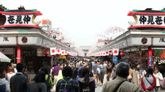 TOKYO - CIRCA MARCH 2013: Zoom out of crowded pathway at Senso-ji temple in Toky Stock Footage