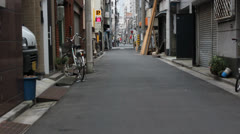 Empty alleyway in Tokyo with Sky Tree visible - stock footage