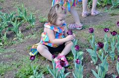 Girl Smelling a Flower at Washington DC Garden Stock Photos