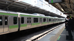 TOKYO - CIRCA MARCH 2013: Train arrives at a Tokyo subway station. Stock Footage