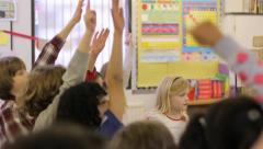 School children raising hands - stock footage